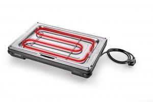 Das Heizelement ist unter der Grillplatte integriert und deckt den gesamten Grillbereich ab.